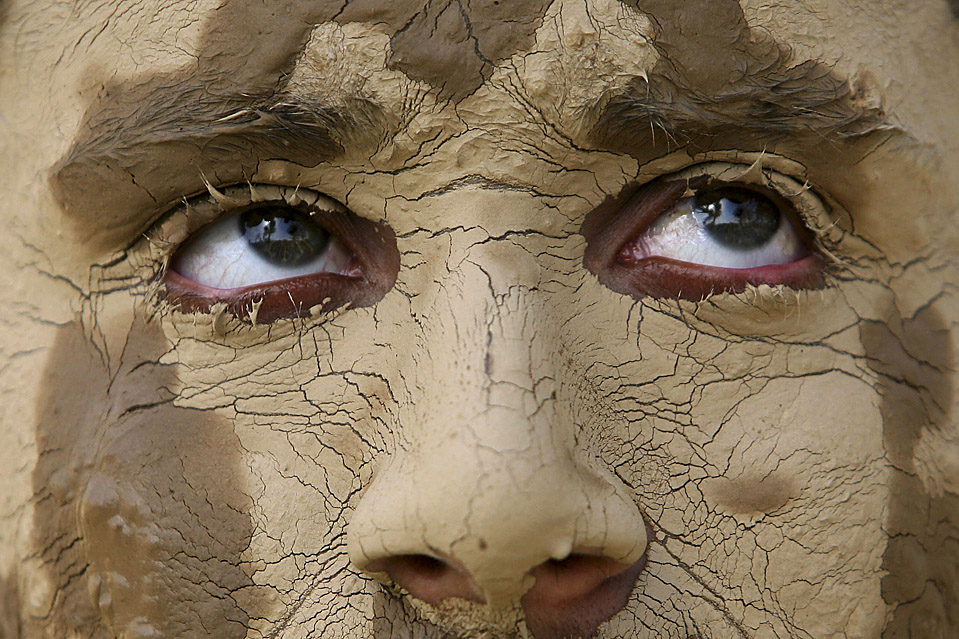 Image result for man covered in mud + image