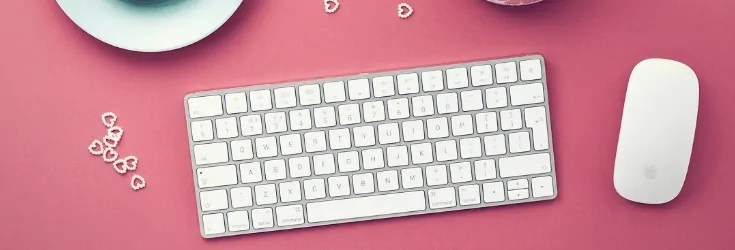 pink desk with keyboard and mouse
