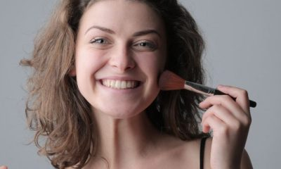 woman-in-black-spaghetti-strap-top-holding-makeup-3979134-1170x400