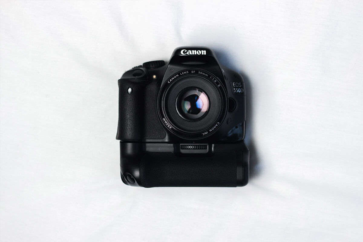 Nothing Can Beat Black Camera On White Silky Cloth