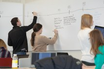 Students work in small groups and use the white board in one of the school's active classrooms (Queen's University, Canada). Further details: http://queensu.ca/activelearningspaces/classrooms/ellis-319-flexibility