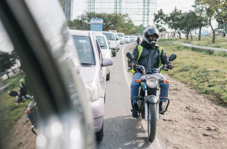 A motorbike driver can cruise past car traffic.