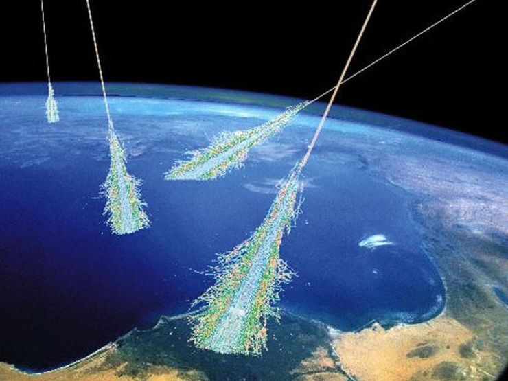 Cosmic rays, which are ultra-high energy particles originating from all over the Universe, strike protons in the upper atmosphere and produce showers of new particles. The fast-moving charged particles also emit light due to Cherenkov radiation as they move faster than the speed of light in Earth's atmosphere, and produce secondary particles that can be detected here on Earth.