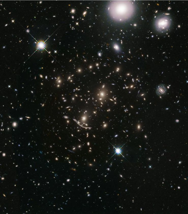 The galaxy cluster Abell 370, shown here, was one of the six massive galaxy clusters imaged in the Hubble Frontier Fields program. Since other great observatories were also used to image this region of sky, thousands of ultra-distant galaxies were revealed. By observing them again with a new scientific goal, Hubble's BUFFALO (Beyond Ultra-deep Frontier Fields And Legacy Observations) program will obtain distances to these galaxies, enabling us to better understand how galaxies formed, evolved, and grew up in our Universe. When combined with intracluster light measurements, we could gain an even greater understanding, via multiple lines of evidence of the same structure, of the dark matter inside.