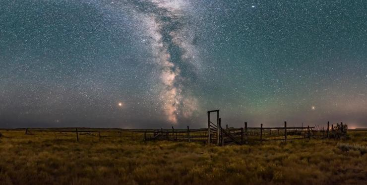 A partial panorama of the summer sky and Milky Way over the historic 76 Ranch Corral in the Frenchman Valley