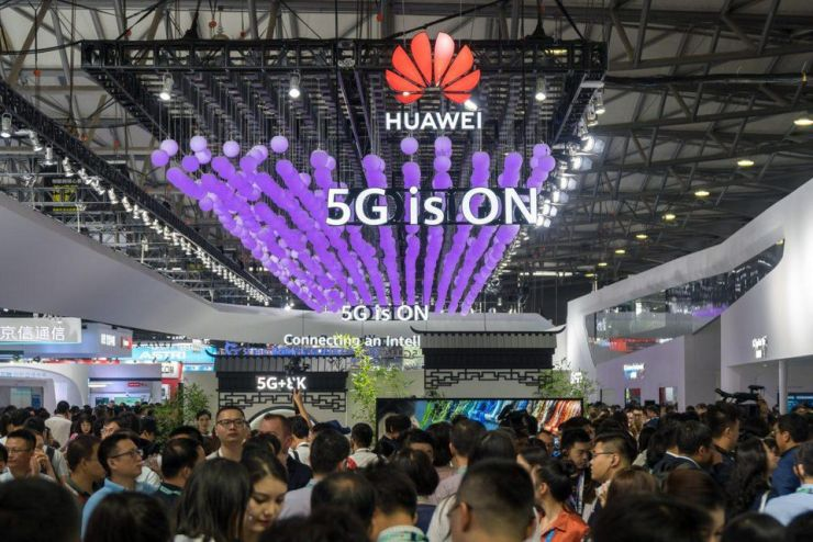 Attendees visit Huawei's booth at the Mobile World Congress (MWC) Shanghai 2019 at the Shanghai New International Expo Center on June 26, 2019.