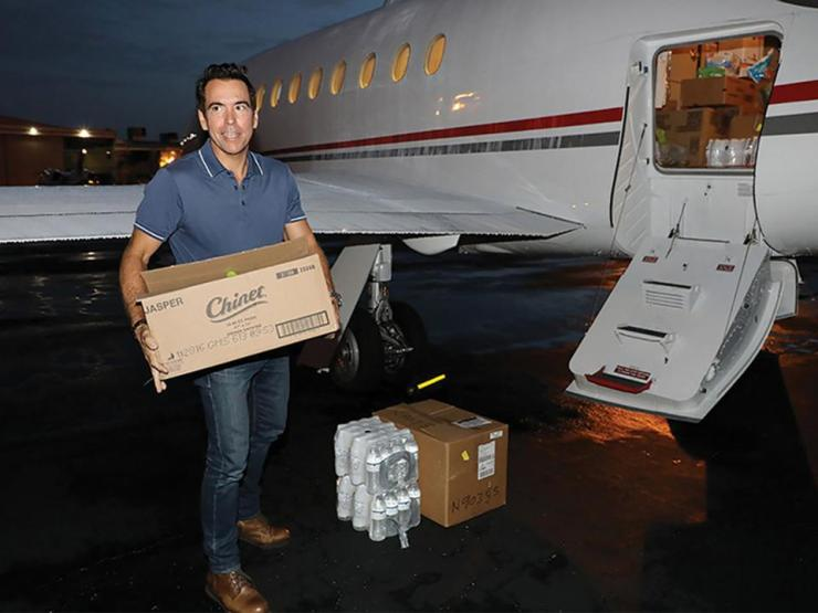 Mission Driven: Days after Hurricane Maria hit his native Puerto Rico, Orlando Bravo loads up a plane in Ft. Lauderdale with hundreds of pounds of supplies, including  hydration pills, IV tubes and diapers.