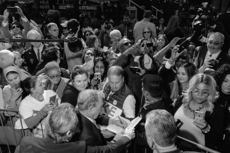 Bloomberg signs autographs and greets supporters at a rally in downtown Houston on Feb. 27.