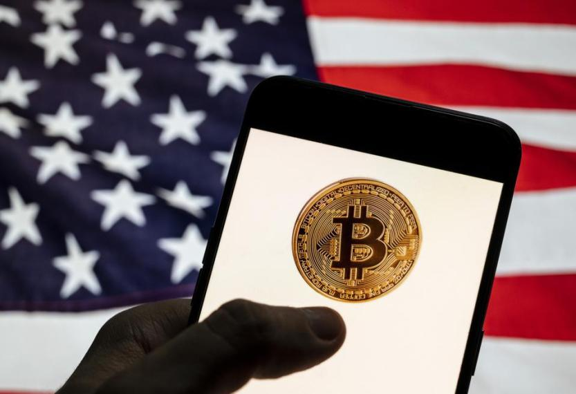 In this photo illustration the cryptocurrency electronic...