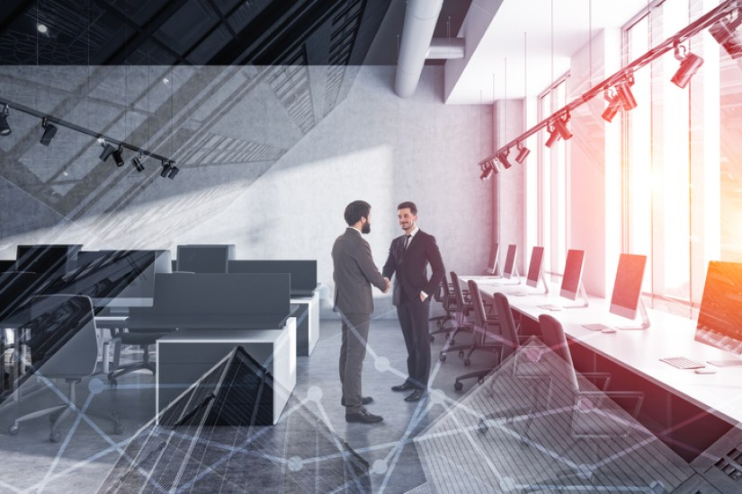 artistic image of two men shaking hands in an office space