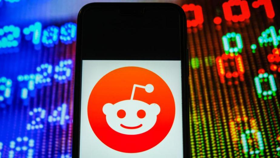 In this photo illustration, a Reddit logo seen displayed on...