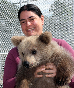 Suzanne Wakim Profile Picture (She ius holding a cute *but scary* cub bear)