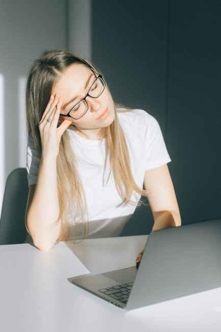 woman in white t shirt wearing black framed eyeglasses