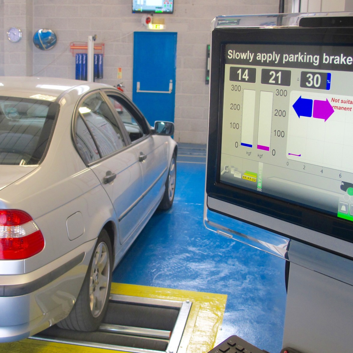 Gallery of images car in mot test centre on brake testing equipment with a screen showing the results