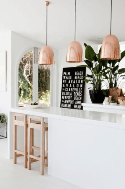 white and copper island kitchen