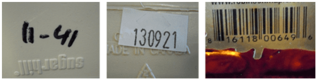 3 different lot codes. One is in sharpie written directly on the container and says 11-41. The second is a small white label with the numbers 130921 printed on it. The third is a barcode.