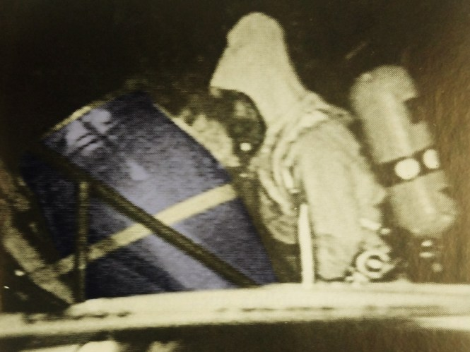 A Hazardous Waste Removal Worker Hauls The Blue Barrel That Contained Several Torsos In Chemical
