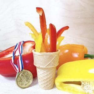 Peppers in an ice cream cone to look like an Olympic torch with an Olympic medal next to it