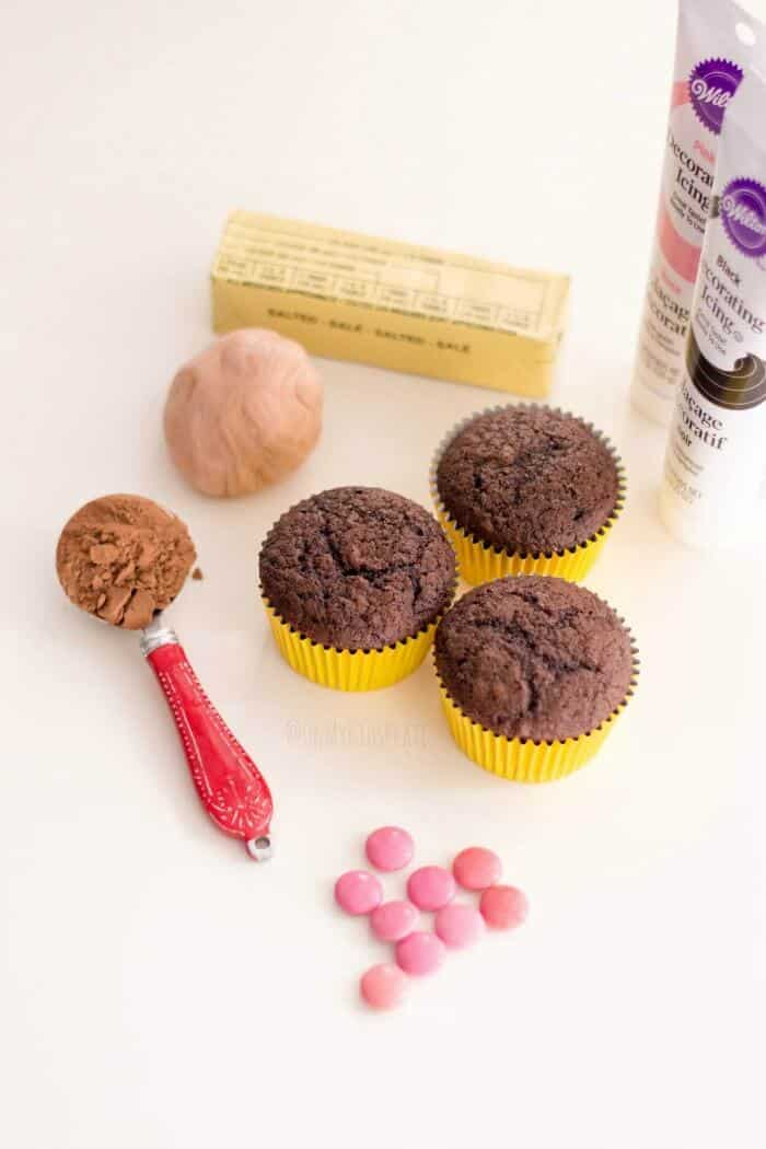 Cupcakes, ingredients for frosting and candy decorations