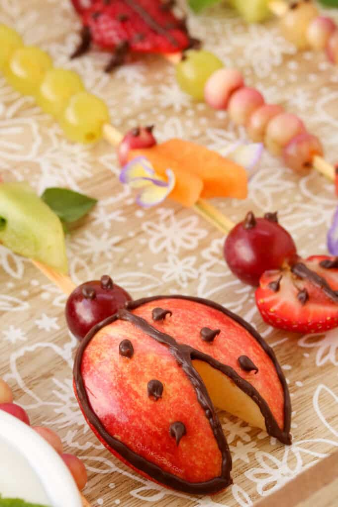 Fruit skewers decorated like lady buys