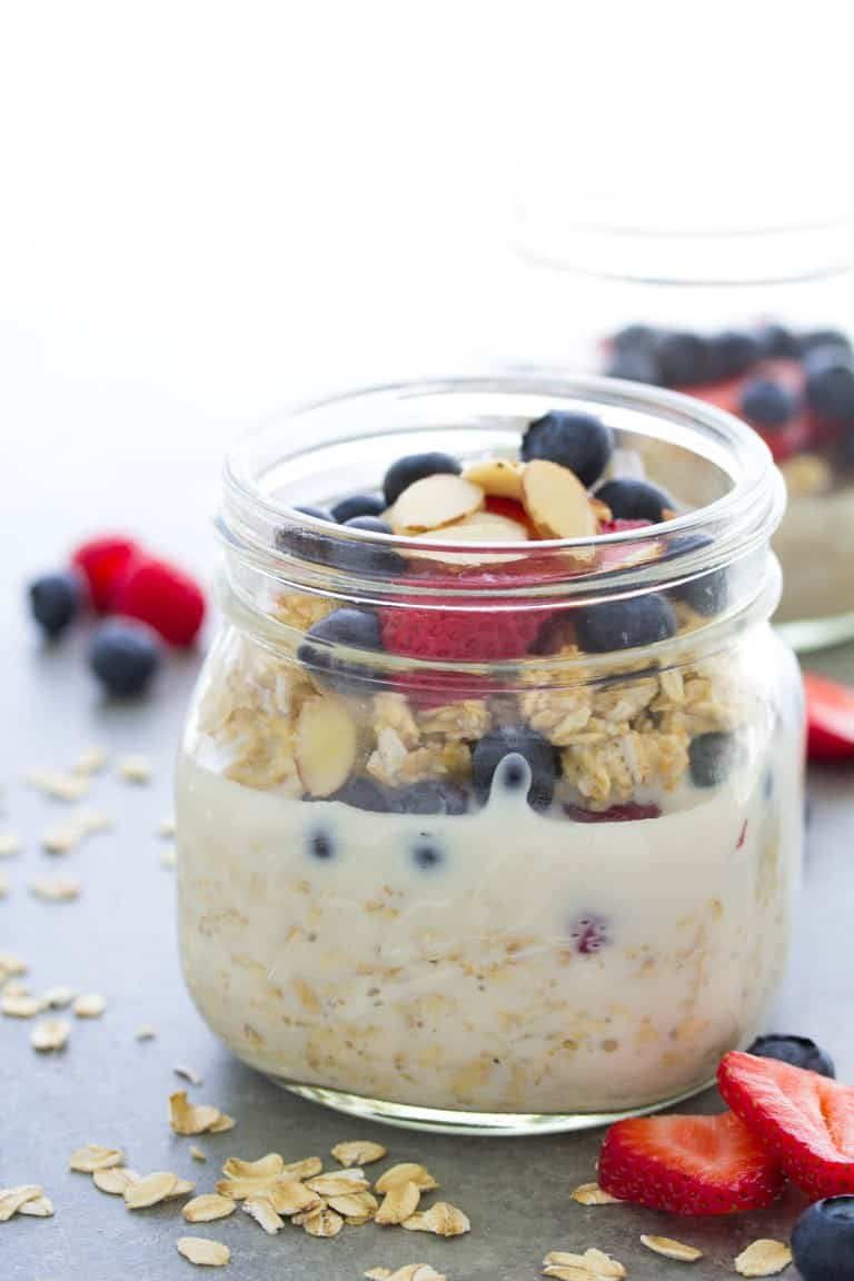 Ovenright oats in a glass jar topped with fruit and nuts