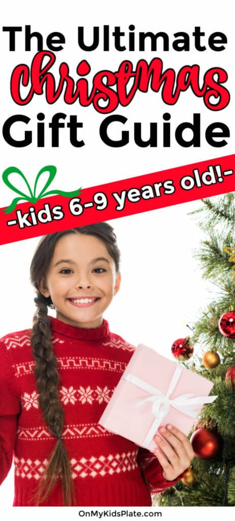 A little girl holding a present and standing next to a Christmas tree  with text title overlay