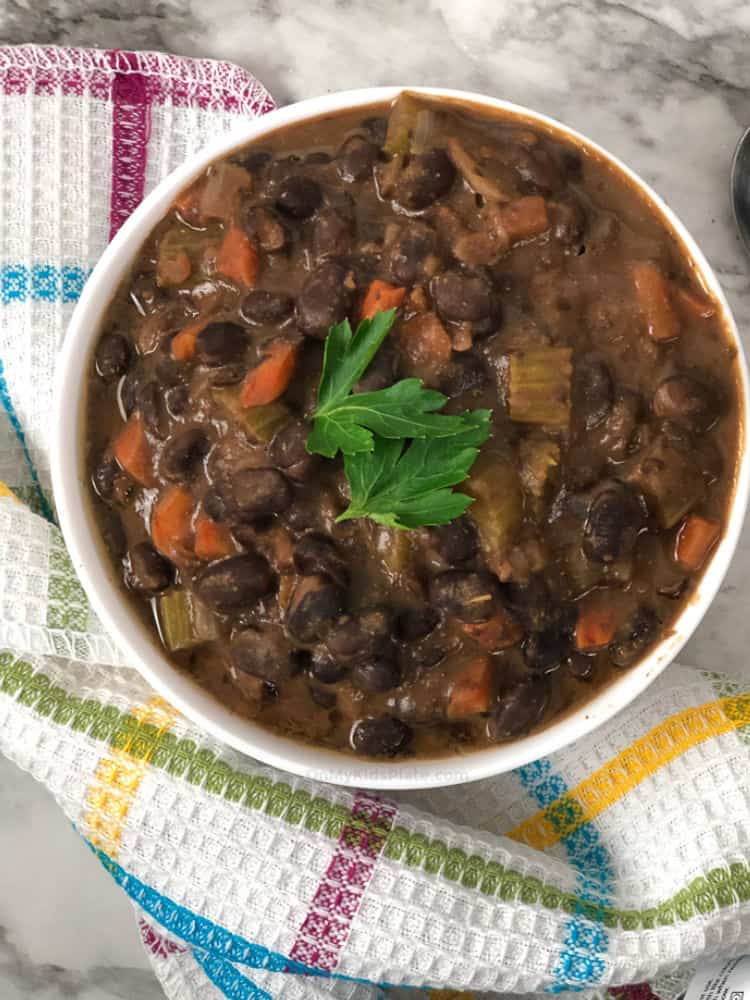 A bowl of black bean soup from overhead