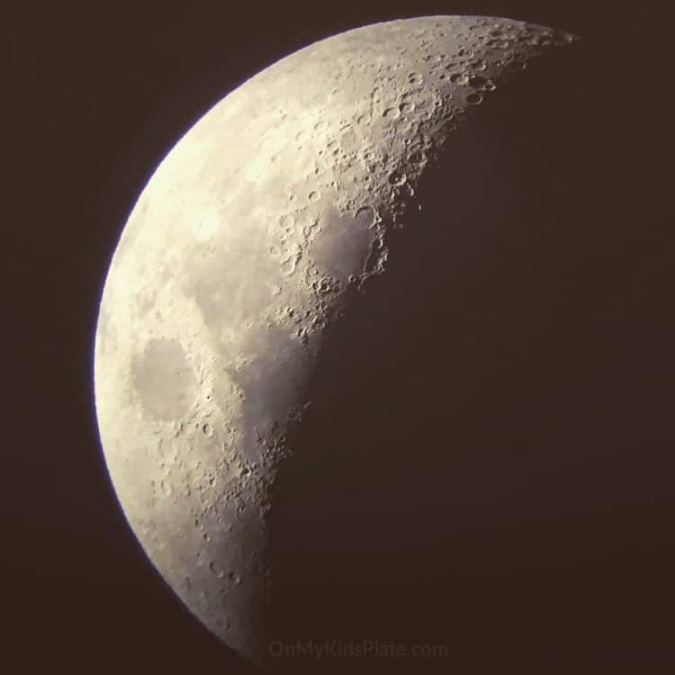 A large picture of the moon in a waning gibbous phase.