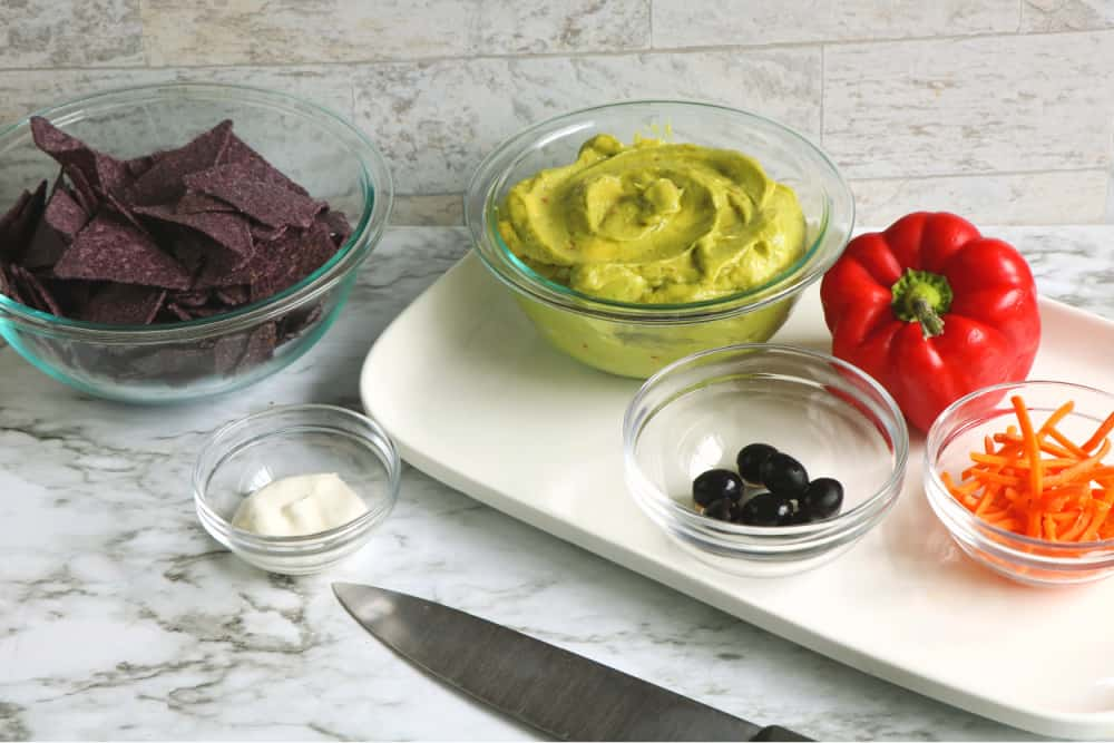 Ingredients to make guacamole platter.