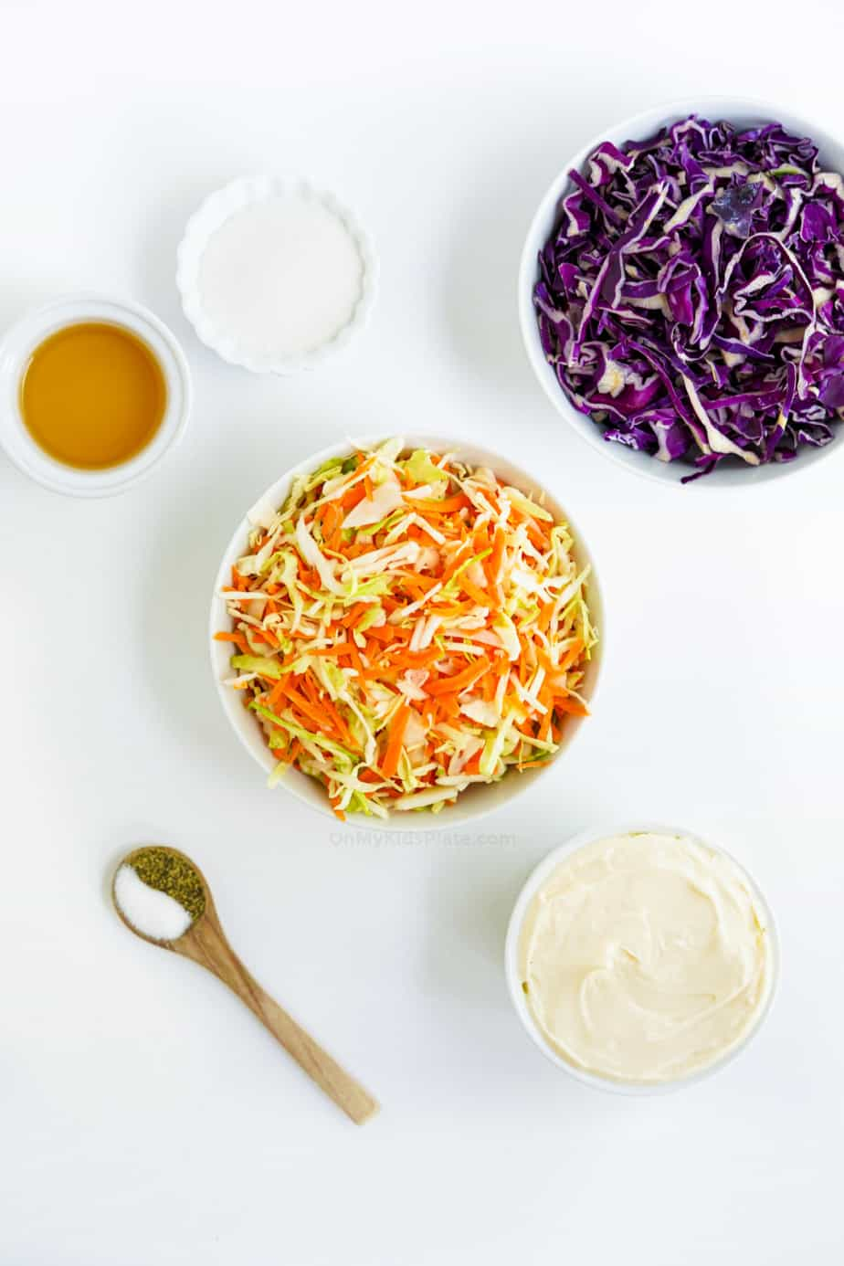 Ingredients for coleslaw from overhead in bowls
