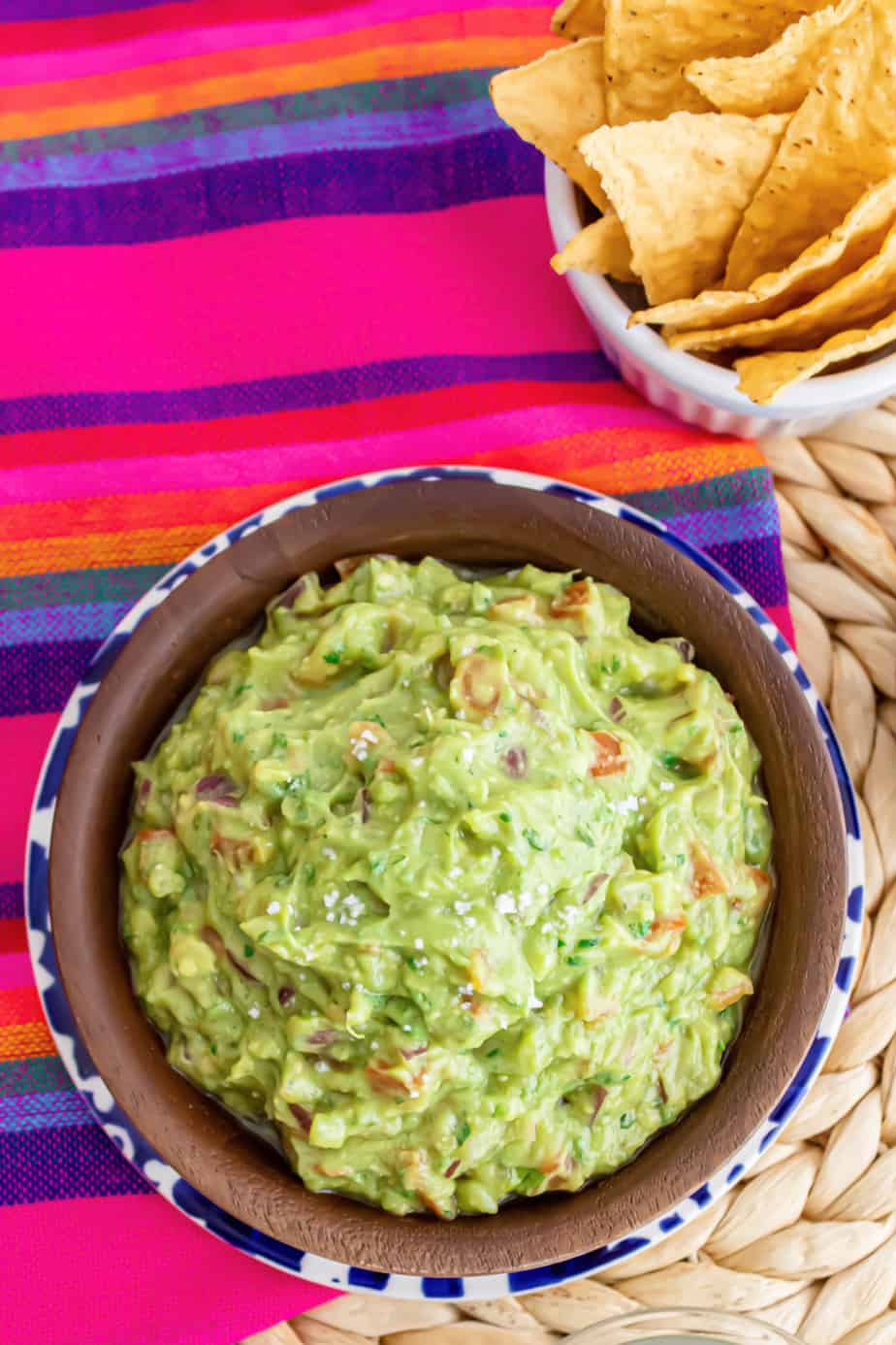 Guacamole in a bowl from overhead with a bowl of chips