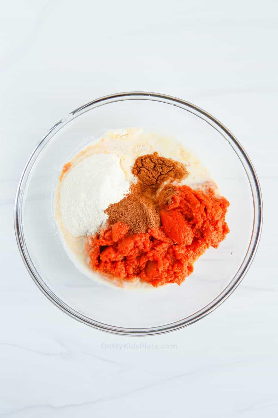 Mixing ingredients for pumpkin pie dip in a bowl