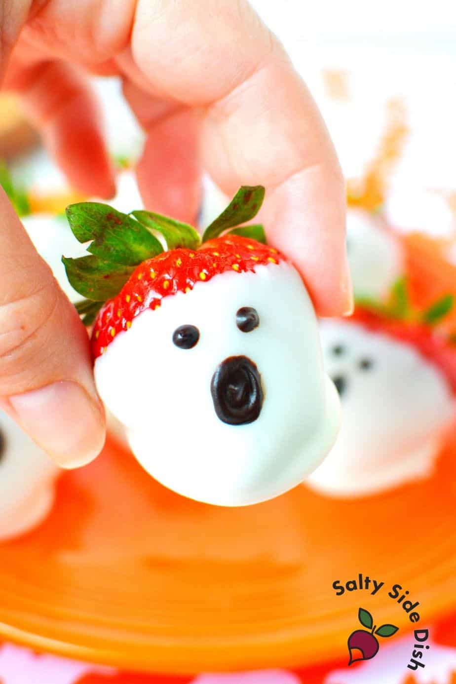 Strawberries dipped in white chocolate and decorated to look like ghosts