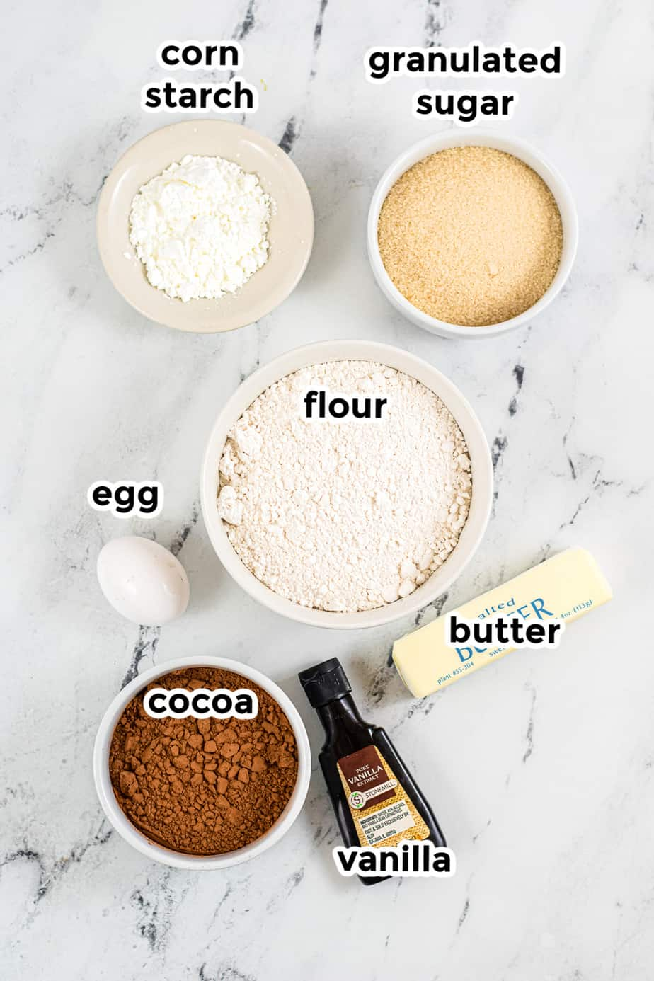 Ingredients for mummy cookie dough in bowls with labels.