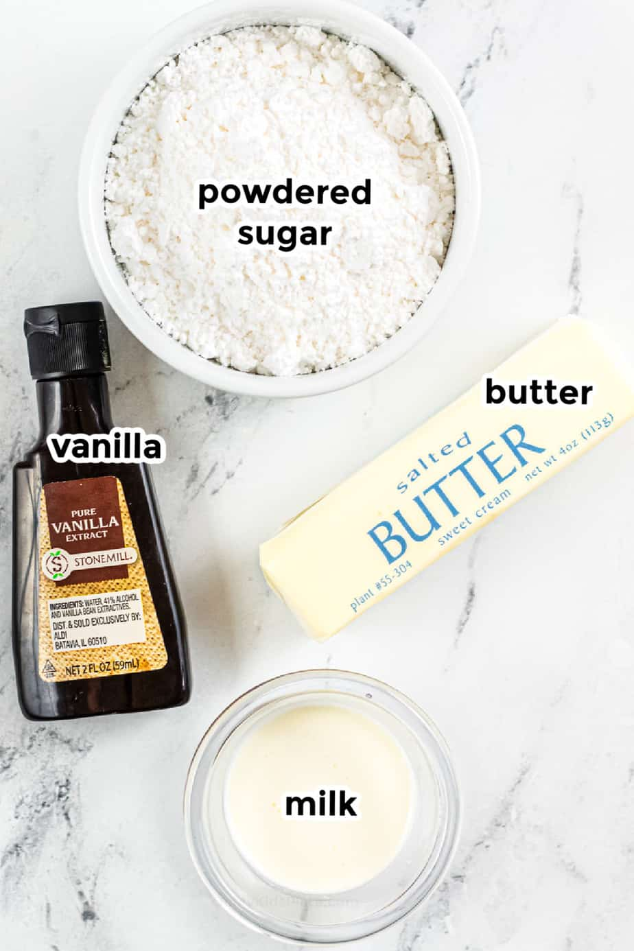 Ingredients for frosting in bowls with labels.