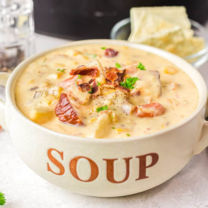Close up image of potato soup in a bowl labeled soup with bacon on top