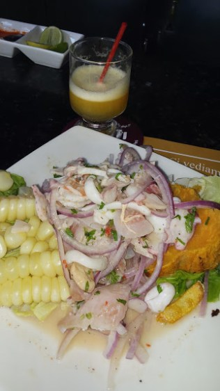 Cebiche mixtoñ traditionally served with yucca and maize (large kerneled corn)