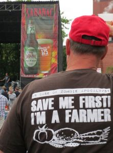 """Here's the GrassWhisperer out enjoying one of the Saranac Thursday concerts, made possible by good planning and writing in time for fun on his grazing chart!  Kathy says, """"Thanks for showing off my Zombie Victory Gardens T-shirt!"""""""