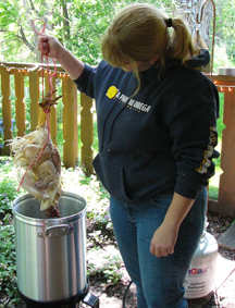 Yep, boiling feathers smell great and the temperature is really easy on the pluckers hands…