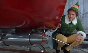 Buddy the elf checks out the Kringle 3000 on Santa's sleigh