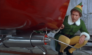 Buddy the elf checks out the Kringle 3000 on Santa's sleigh