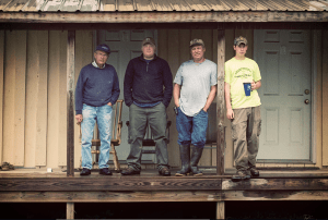 Three generations of Prigels under one porch. Bobby's father stands at the left, and Bobby is flanked by his sons Bo and Matt.