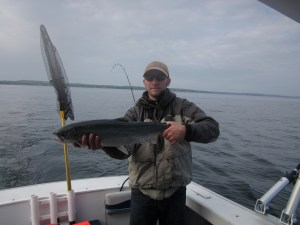 Darrell's son Nick with a nice steelhead, even though it's not a brown trout