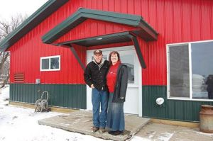 Rich and Carol outside their new milking facility. Photo courtesy of the Dairy Star.