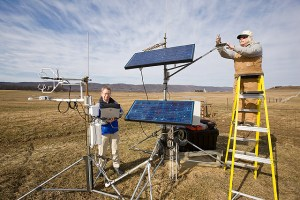 Plant physiologist Howard Skinner (left) and technician Steve LaMar check sensors and download carbon dioxide flux data from an eddy covariance system on a pasture at Penn State's Haller Research Farm. The data is used to monitor carbon sequestration on pastures and contribute to whole farm carbon footprint modeling.
