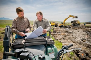 Jeff Lazlo of Granger Ranches and Jon Jourdonnais of PPL MT, review Phase IV of O'Dell Project plans during construction in 2008.