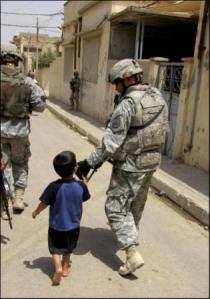 Soldier Walking Down Street With Iraqi Boy