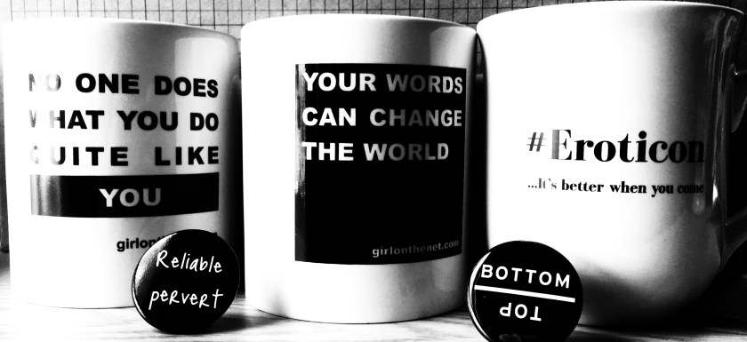 Black and white photo of the 2017, 2018 and 2019 Eroticon mugs, accompanied by pin badges with 'Reliable pervert' and 'Bottom/Top' written on them.