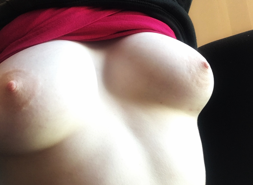 Tits peaking out from a pulled up shirt. Photo.