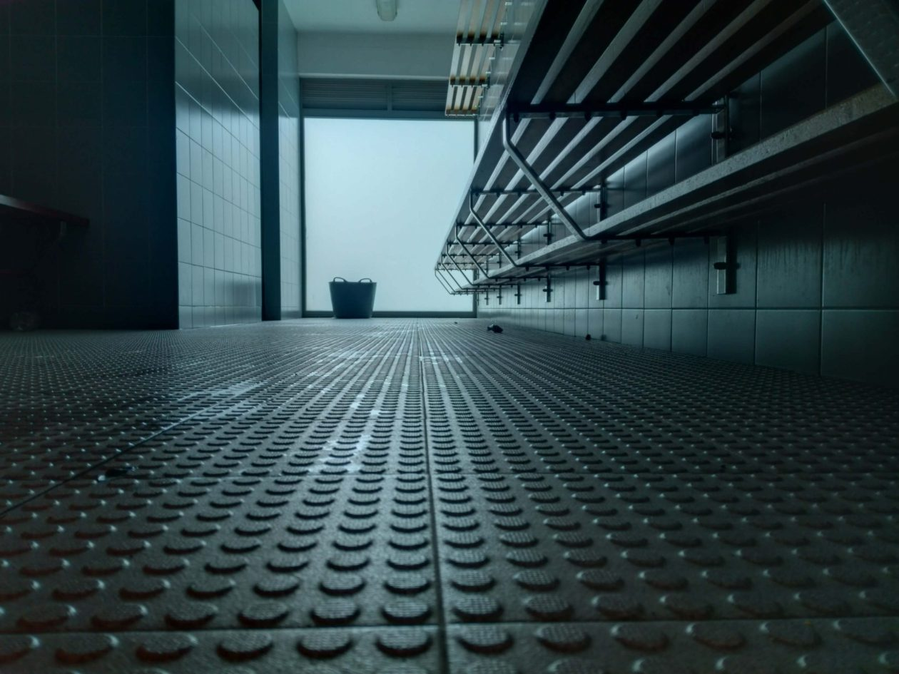View of a locker room shower. Photo.